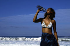 Drinking woman. Mixed woman drinking bottle of water Royalty Free Stock Photography