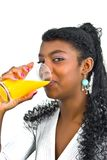 Drinking yellow orange juice Stock Image