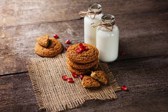 Drinking yogurt in bottles and cookies, selective focus Royalty Free Stock Image