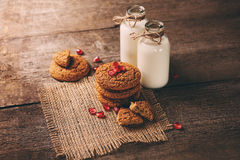 Drinking yogurt in bottles and cookies, selective focus Royalty Free Stock Photos
