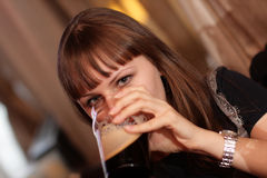 Drinking young woman Stock Photo