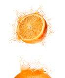 drinkorangefärgstänk arkivbild