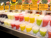 Drinks. Colorful fruit juices in La Boqueria (Barcelona famous marketplace Royalty Free Stock Image