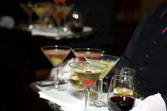 Drinks. Trays filled with alcoholic beverages at a reception Stock Image