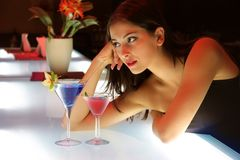 Drinks. Portrait of a young woman in a restaurant Royalty Free Stock Images