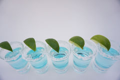 Drinks. Alcohol lime background party bar blue Royalty Free Stock Photos