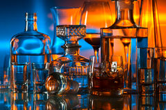 Drinks in bar. Alcoholic drinks in bar on glass table Stock Images