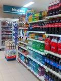 Beverage shelves. Drinks and beverages in shelves at supermarket Stock Photography
