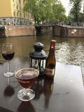 Drinks on the Canal. Enjoying afternoon drinks canal side in Amsterdam Stock Image