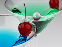 Drinks, cherries, glasses and stir Stock Photos