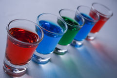 Drinks. Color red green blue white art glass background beautiful Royalty Free Stock Images