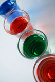 Drinks. Color red green blue white art glass background beautiful Stock Photography