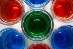 Drinks. Color red green blue white art glass background beautiful Stock Image