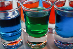 Drinks. Color red green blue white art glass background beautiful Stock Images