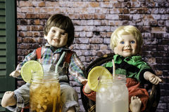 Drinks and Dolls Stock Photos