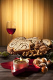 Drinks and food for christmas. Traditional red wine and sponge cake decorating christmas table stock image