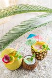 Drinks in fresh fruits in sunny day. On white pebbles Stock Photography