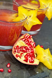 Drinks with Fresh pomegranate Stock Images