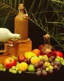 Drinks and fruit abundance stock images