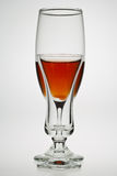 Drinks glasses. Backlit drinks glasses with orange coloured drink Royalty Free Stock Photo
