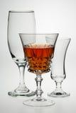 Drinks glasses. Backlit drinks glasses with orange coloured drink Royalty Free Stock Images