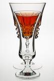 Drinks glasses. Backlit drinks glasses with orange coloured drink Royalty Free Stock Image