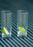 Drinks glasses with lime Royalty Free Stock Photography