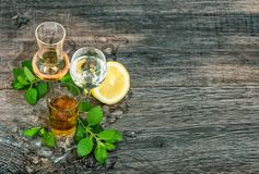 Drinks with ice lemon mint leaves Food beverages. Alcoholic drinks with ice, lemon, mint leaves on wooden background. Food beverages stock images