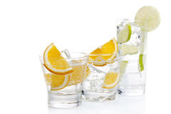 Three cocktails. Drinks with orange and a lime on a white background Royalty Free Stock Image