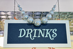 Drinks plate with decorating and silver balls Royalty Free Stock Photo