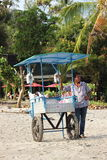 Drinks For Sale. A beach vendor selling drinks on the beach at Manuel Antonio in Costa Rica Royalty Free Stock Photography