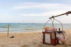Drinks for sale on the beach. Vendors basket standing on a beach in Thailand Stock Images
