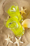 Drinks on sand and shells Royalty Free Stock Photography