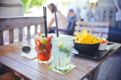 Drinks and snacks on table Royalty Free Stock Images