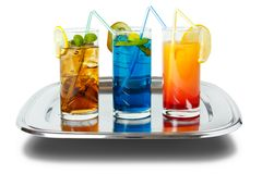 Drinks on tray. Three colourful long drinks on tray , isolated on white with shadow Royalty Free Stock Photo