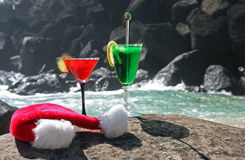 Drinks for two. Mr and Mrs Klaus have left their Christmas cocktails on the rock by the ocean and gone for a swim on Boxing day, after a big night stock photos