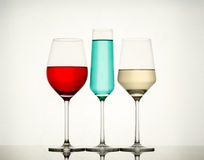 Drinks in various alcoholic glasses Royalty Free Stock Images