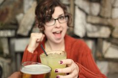 Drinks with young woman Stock Photography