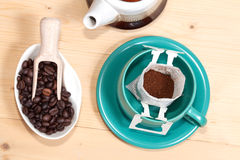 Drip bag fresh coffee in cup. On table wood Stock Photos