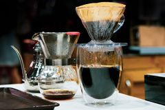Drip coffee brewing, Barista pouring water on coffee ground with filter stock photo