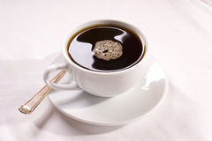 Drip coffee with bubbles. A cup of drip coffee Stock Image