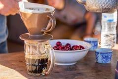 Drip Coffee. Fresh coffee drip ceramic cup Stock Images