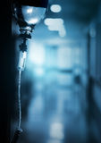 Drip in hospital on the background of dark empty corridor royalty free stock images