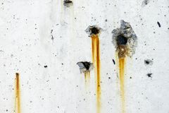 Rusty metal staining on white concrete wall surface royalty free stock images