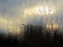 Dripped in rain on glass. Window royalty free stock photos