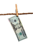 A dripping 20 dollar bill on a clothesline. Money laundering concept royalty free stock photos