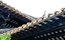 The dripping eaves tiles and clay sculpture of eaves Royalty Free Stock Photo