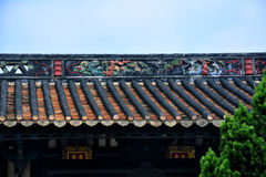 The dripping eaves tiles and clay sculpture of eaves Stock Image