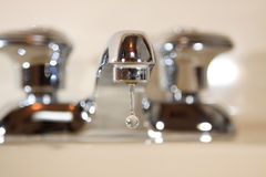 Dripping faucet Stock Images