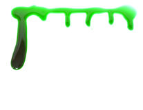 Dripping green blood. Isolated on white Royalty Free Stock Photo